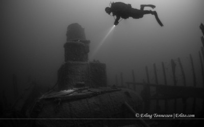 A diver at the boiler of the wreck Oliva