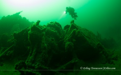 A diver swims towards the remains of the bow on the wreck Ds Bergen outside Mandal