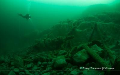 A diver examines the remains of the Bark Tajlf